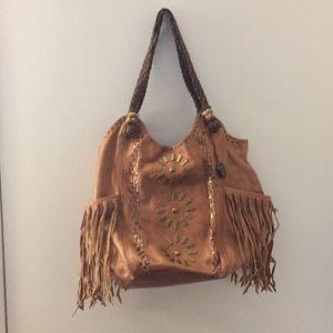 The Sak brand brown leather hobo bag